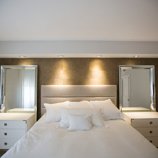 Mid-sized transitional master limestone floor and gray floor bedroom photo in Miami with brown walls and no fireplace