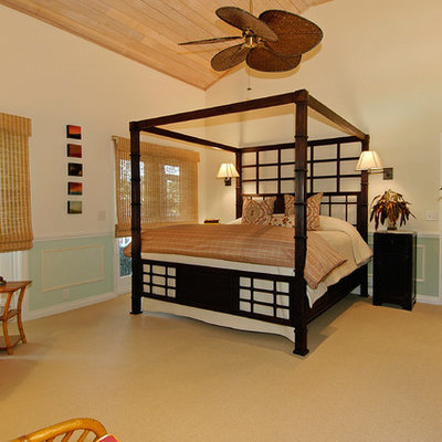 Large island style master carpeted and brown floor bedroom photo in Miami with beige walls and no fireplace