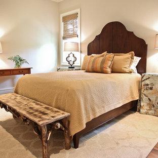 Bedroom - beach style medium tone wood floor bedroom idea in Charleston with gray walls