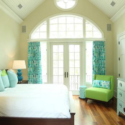 Inspiration for a coastal medium tone wood floor bedroom remodel in Charleston with beige walls