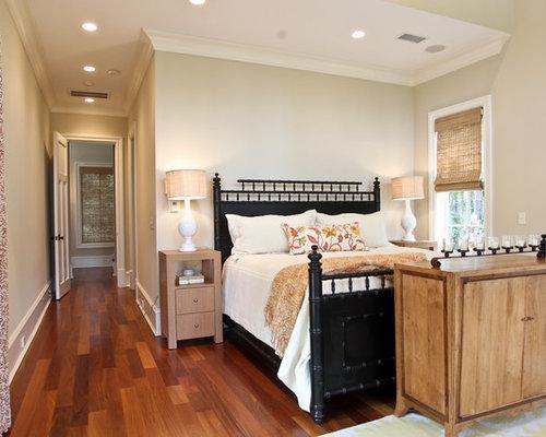 coastal dark wood floor bedroom photo in charleston with beige walls