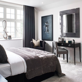 Photo of a medium sized classic bedroom in London with white walls, carpet and grey floors.