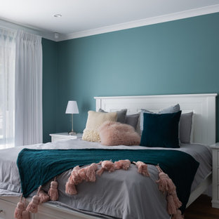 Photo of a transitional bedroom in Perth with blue walls.