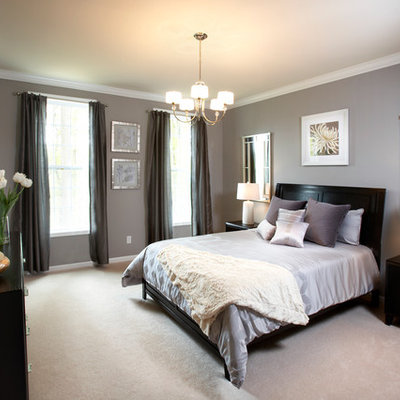 Inspiration for a mid-sized transitional master carpeted bedroom remodel in New York with gray walls and no fireplace