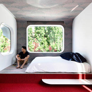 Inspiration for a contemporary bedroom in Melbourne with carpet and red floor.
