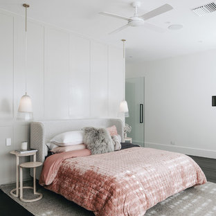 Inspiration for a contemporary bedroom in Adelaide with white walls, dark hardwood floors and black floor.