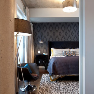 Inspiration for a large contemporary master bedroom in Toronto with black walls, dark hardwood floors and brown floor.