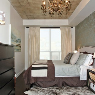 Design ideas for a mid-sized country loft-style bedroom in Toronto with multi-coloured walls, dark hardwood floors and no fireplace.