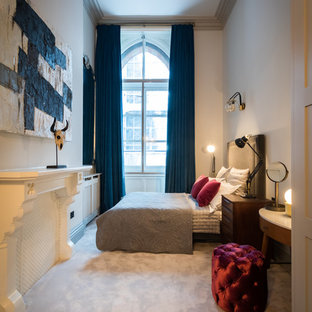 Design ideas for a contemporary bedroom in London with white walls, carpet and grey floors.
