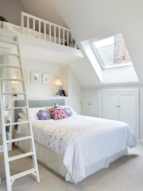 Elegant loft-style bedroom photo in London