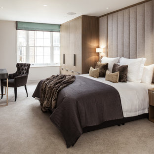 Photo of a medium sized classic master bedroom in London with beige walls, carpet and beige floors.