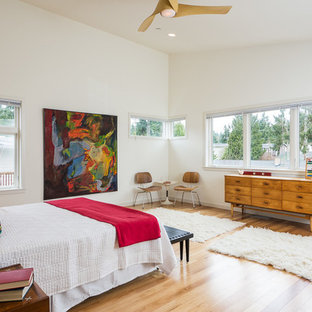 Design ideas for a midcentury bedroom in Seattle with white walls and medium hardwood floors.