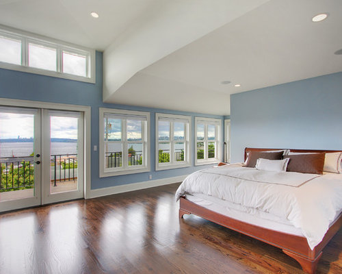 Example Of A Classic Medium Tone Wood Floor Bedroom Design In Seattle With  Blue Walls