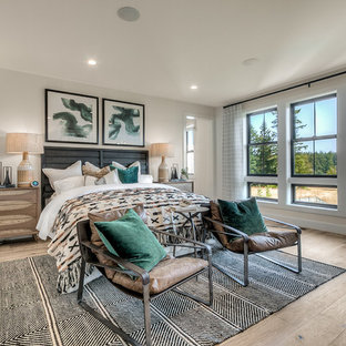 Bedroom - transitional master light wood floor bedroom idea in Seattle with white walls