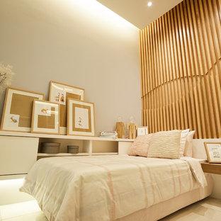 Imagen de habitación de invitados nórdica, pequeña, sin chimenea, con paredes grises y suelo de baldosas de porcelana