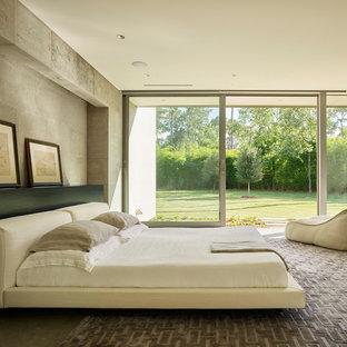 Modelo de dormitorio moderno con paredes grises, suelo de cemento y suelo gris
