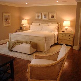 Bedroom - traditional master medium tone wood floor bedroom idea in Los Angeles with beige walls