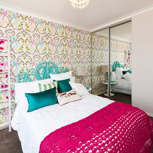 Trendy carpeted bedroom photo in Perth with multicolored walls