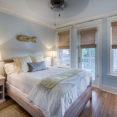 Beach style guest light wood floor bedroom photo in Miami with blue walls