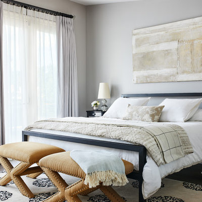 Bedroom - transitional dark wood floor and brown floor bedroom idea in Los Angeles with gray walls