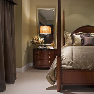 Elegant carpeted bedroom photo in Orange County with green walls