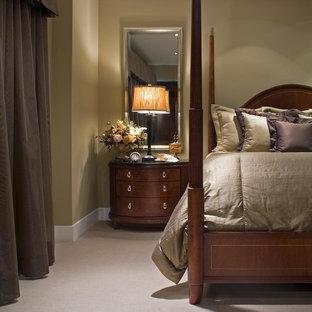 Idée de décoration pour une chambre avec moquette tradition avec un mur vert.