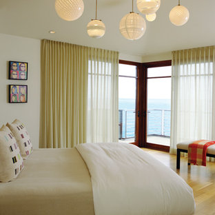 Minimalist light wood floor bedroom photo in Orange County with beige walls