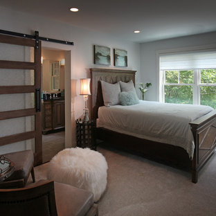 Photo of a medium sized rustic guest bedroom in Atlanta with white walls and carpet.