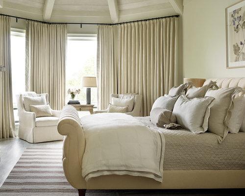 example of a master light wood floor bedroom design in atlanta with beige walls