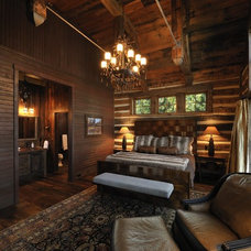 Rustic Bedroom by Lake Country Builders