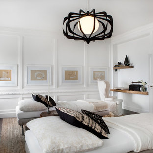 Photo of a large farmhouse guest bedroom in Chicago with white walls, dark hardwood flooring and no fireplace.