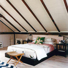 Rustic Bedroom by Thom Filicia Inc.