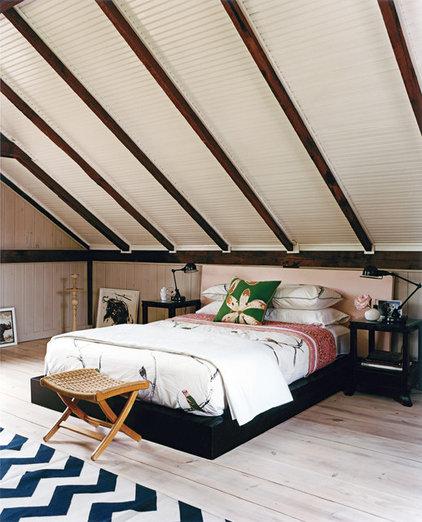 Rustic Bedroom by Thom Filicia Inc.