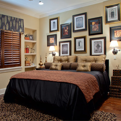 Mid-sized elegant dark wood floor bedroom photo in Orlando with beige walls and no fireplace