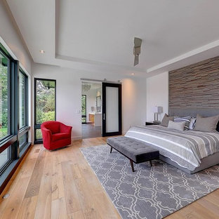 Large trendy master light wood floor bedroom photo in Portland with white walls and no fireplace