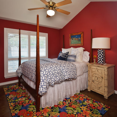 Mid-sized elegant guest concrete floor bedroom photo in Austin with red walls