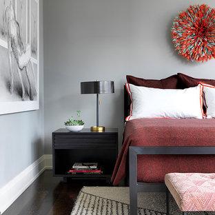 Trendy dark wood floor and brown floor bedroom photo in Chicago with gray walls
