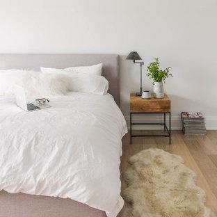 Danish light wood floor bedroom photo in Toronto with white walls