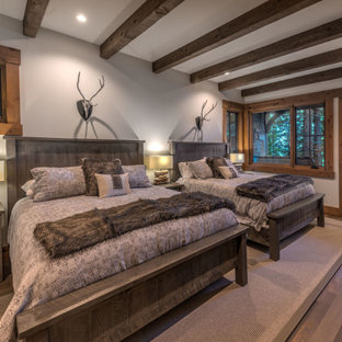 Inspiration for a large arts and crafts guest bedroom in Other with grey walls, medium hardwood floors and brown floor.