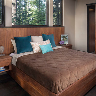 This is an example of a rustic bedroom in San Francisco with beige walls and no fireplace.