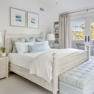 Beach style master carpeted and beige floor bedroom photo in Los Angeles with white walls