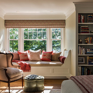 Inspiration for a timeless medium tone wood floor and brown floor bedroom remodel in Boston with beige walls