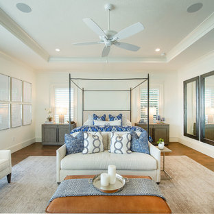 Inspiration for a large transitional master dark wood floor and brown floor bedroom remodel in Orlando with white walls