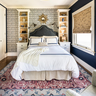 Example of a transitional master medium tone wood floor bedroom design in San Francisco with blue walls