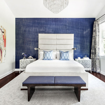 Inspiration for a transitional dark wood floor bedroom remodel in New York with blue walls