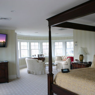 Inspiration for a large timeless master carpeted and beige floor bedroom remodel in Boston with beige walls and no fireplace