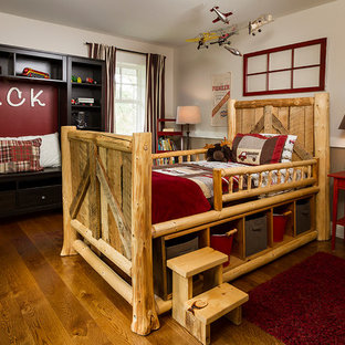Mid-sized cottage medium tone wood floor bedroom photo in Minneapolis with brown walls