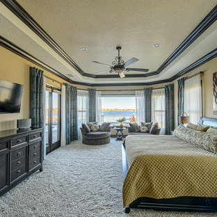 Inspiration for a large eclectic master carpeted bedroom remodel in Orlando with beige walls and no fireplace