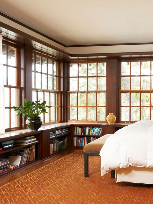 Traditional dark wood floor and orange floor bedroom idea in Minneapolis  with beige walls - Dark Wood Bookcase Houzz