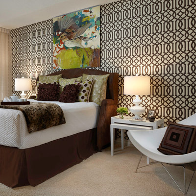 Inspiration for a large contemporary master carpeted bedroom remodel in Miami with brown walls